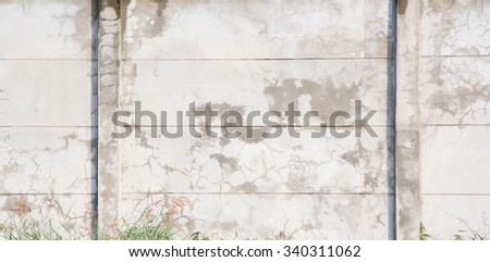 gray concrete wall with two concrete poles with copy space for text  - stock photo