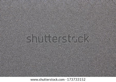 Gray foam air filter as background - stock photo