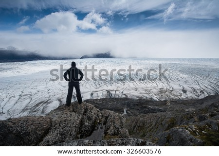 Gray Glacier and silhouette of woman, Torres del Paine National Park, Patagonia, Chile - stock photo