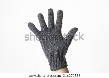Gray glove on hand. Isolated on a white background. - stock photo