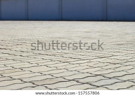 Gray interlocking paving stone driveway - stock photo