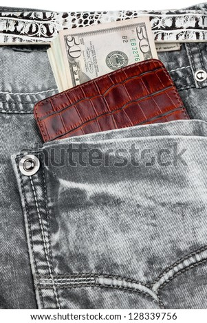 Gray jeans pocket with purse and money,concept - stock photo