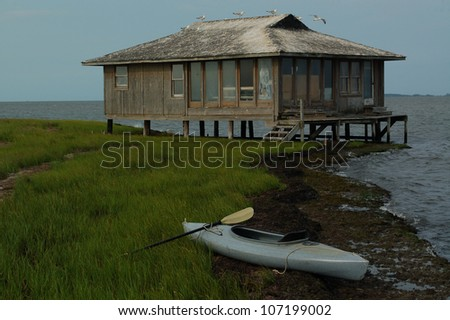 Beach shack stock images royalty free images vectors for Hunting shack designs