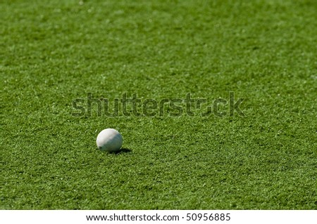Gray lacrosse ball on grass