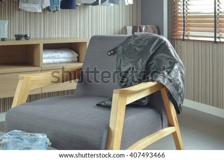 Gray lounge chair at walk in closet