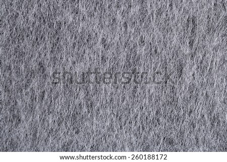 Gray nonwoven fabric texture background - stock photo