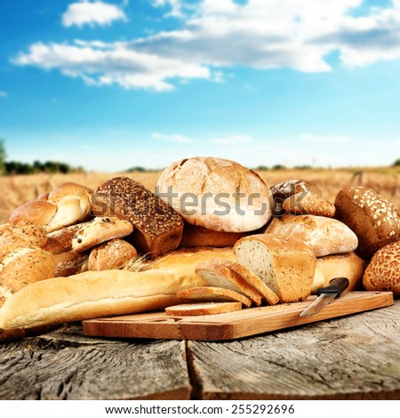 gray old table and wooden desk of bread  - stock photo