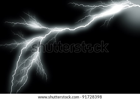 Gray-scaled picture of a lightning bolt on a black background - stock photo