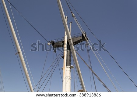 Gray ship masts with rigging