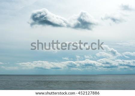Gray sky over gulf of Riga, Baltic sea. - stock photo