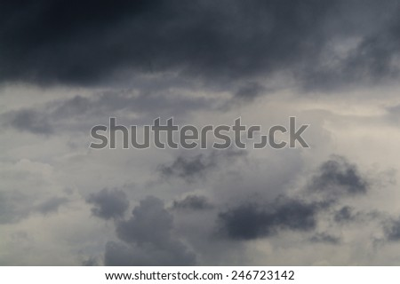 Gray sky with dark torn clouds. - stock photo