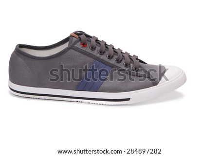 gray sneakers isolated - stock photo