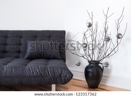 Gray sofa and simple winter decorations in the living room. - stock photo