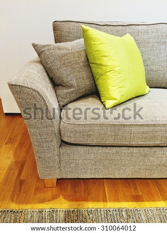 Gray sofa with cushions in the living room. Modern furniture. - stock photo