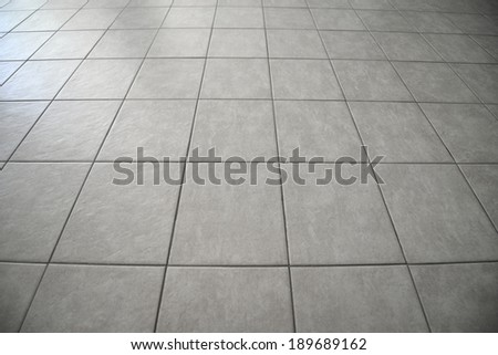 Gray tiled floor background - stock photo