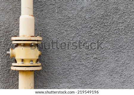 gray wall gas pipe rust points