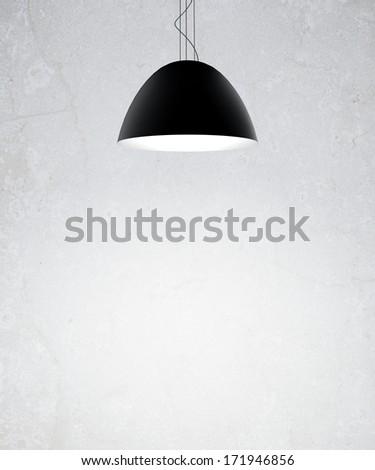 gray wall with black ceiling lamps - stock photo