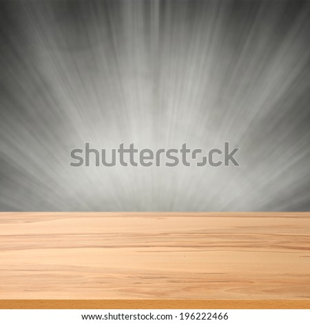 gray wall with light and yellow desk  - stock photo