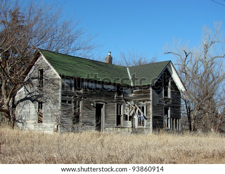 gray weathered farm building - stock photo