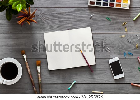 Gray, wooden table top view of the artist. On the table are the objects for drawing creatively on the surface of the table, designed for easy operation. - stock photo