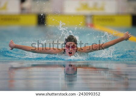 GRAZ, AUSTRIA - APRIL 04, 2014: Tina Purner (Austria) places 5th in the women's 4x100m medley event in an indoor swimming meeting. - stock photo