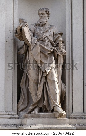 GRAZ, AUSTRIA - JANUARY 10, 2015: Saint Paul the Apostle on the facade of Parish Church of the Holy Blood in Graz, Styria, Austria on January 10, 2015. - stock photo
