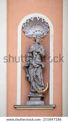 GRAZ, AUSTRIA - JANUARY 10, 2015: Virgin Mary on the portal of Dreifaltigkeitskirche ( Holy Trinity ) church in Graz, Styria, Austria on January 10, 2015. - stock photo