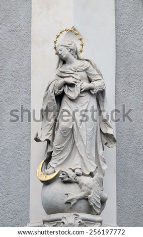 GRAZ, AUSTRIA - JANUARY 10, 2015: Virgin Mary, statue on the house facade in Graz, Styria, Austria on January 10, 2015. - stock photo