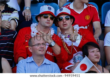 GRAZ, AUSTRIA - JULY 9: Austrian fans pose for a photo at the Football World Championship on July 9, 2011 in Graz, Austria. Japan wins 24:6 against Austria. - stock photo