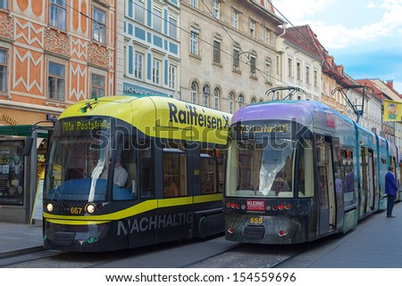 GRAZ, AUSTRIA - JULY 15 : Tram on Main Square (Hauptplatz) on July 15, 2013 Graz, Austria.