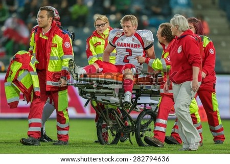 GRAZ, AUSTRIA - MAY 31, 2014: LB Timmi Kleinnibbelink Rysgaard (#2 Denmark) is transported off the field after an injury. - stock photo