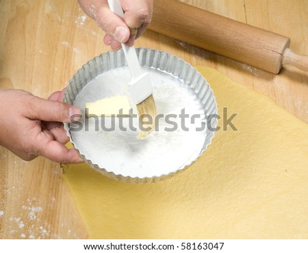 greasing the cake mould - stock photo