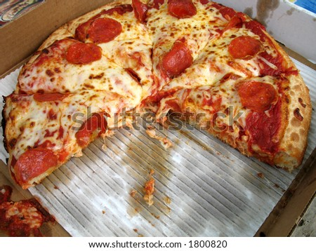greasy american deep dish pepperoni pizza in a box - stock photo