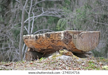 great altar in the middle of the forest consists of a big tree trunk - stock photo