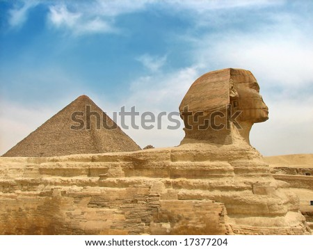 great ancient sculpture of egyptian sphinx and pyramid - stock photo
