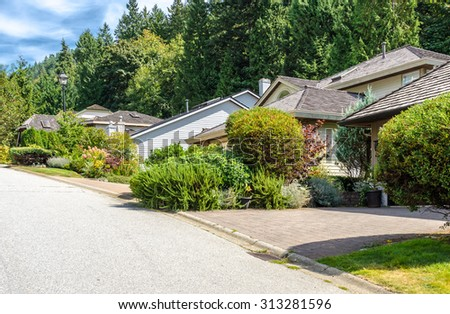 Great and comfortable neighborhood, modern houses in suburbs of Vancouver, Canada. - stock photo