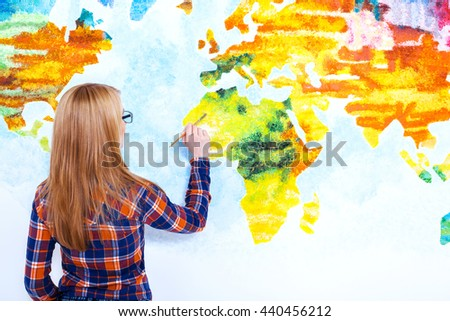 Great artist. Closeup of an attractive  young woman painting the wall - stock photo