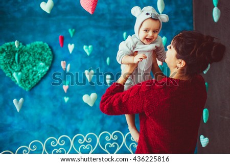 great baby  and his mom have fun  time - stock photo