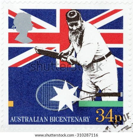 GREAT BRITAIN - AUGUST 10, 2015: A stamp printed by GREAT BRITAIN shows Cricketer and Tennis Rack against Union Jack flag. Australian Bicentenary, circa June, 1988