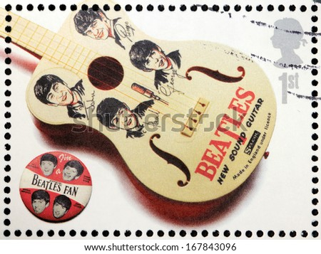 GREAT BRITAIN - CIRCA 2007: A stamp printed by Great Britain shows the Beatles memorabilia (guitar and pin), circa 2007. - stock photo