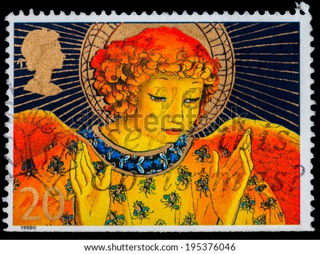 GREAT BRITAIN - CIRCA 1998: a stamp printed in the Great Britain shows Christmas Angel, circa 1998   - stock photo