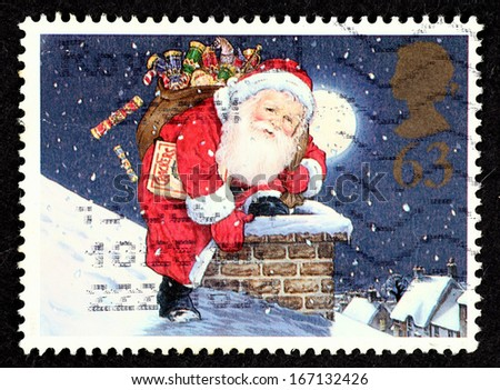 GREAT BRITAIN - CIRCA 1997: Stamp printed in Great Britain with image of Father Christmas and Chimney from Christmas series for 150th Anniversary of the Christmas Cracker, circa 1997. - stock photo