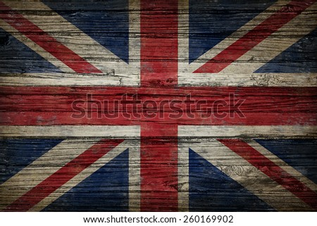 Great Britain flag painted on old weathered,wood as an old vintage British and United Kingdom concept of a symbol of historical patriotism and English culture on an antique textured material. - stock photo