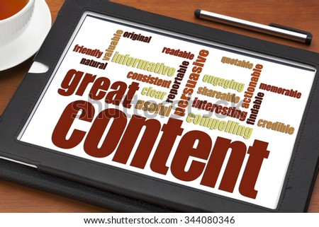 great content writing word cloud on a digital tablet with a cup of tea- bloging, business writing and content marketing concept - stock photo