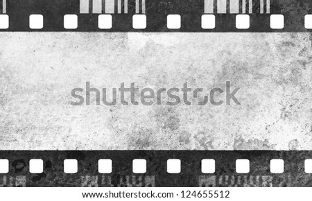 Great dark film strip for textures and backgrounds with light leak - stock photo