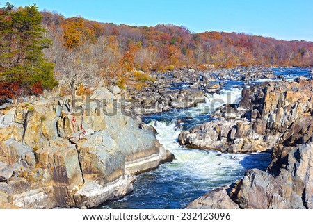 Great Falls National Park in autumn, Virginia USA. Colorful foliage and blue waters of Potomac at park in the morning. - stock photo