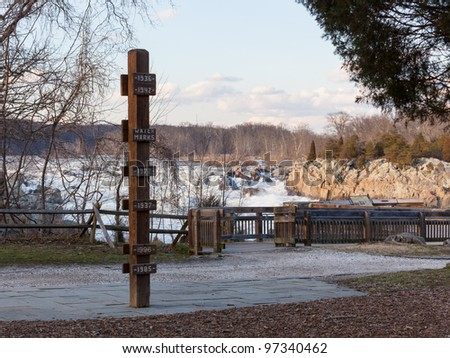 Great Falls on Potomac river outside Washington DC with flood marker pole - stock photo