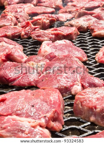 Great Fresh Steak just put on a home made barbecue. Greater depth of field. - stock photo