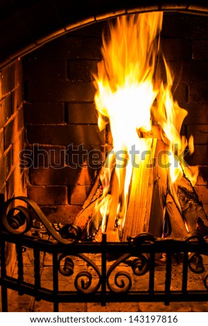 Great Home Fire burning in brick fireplace. Seasonal and holiday fire, Closeup - stock photo