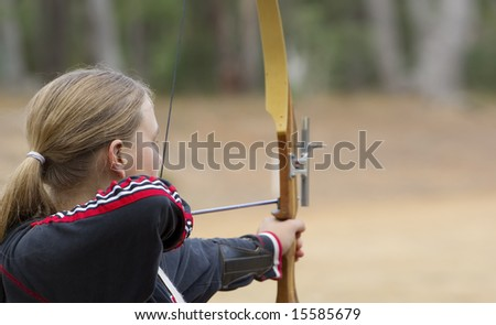 great image of a teenage girl doing archery - stock photo